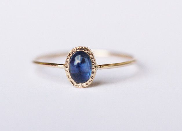 Dainty  oval blue sapphire ring handcrafted in 14k gold.  _Sapphires are birthstones of  September_  CENTRAL STONE:      blue sapphire- natural, Earth mined gemstone      shape: oval    ...