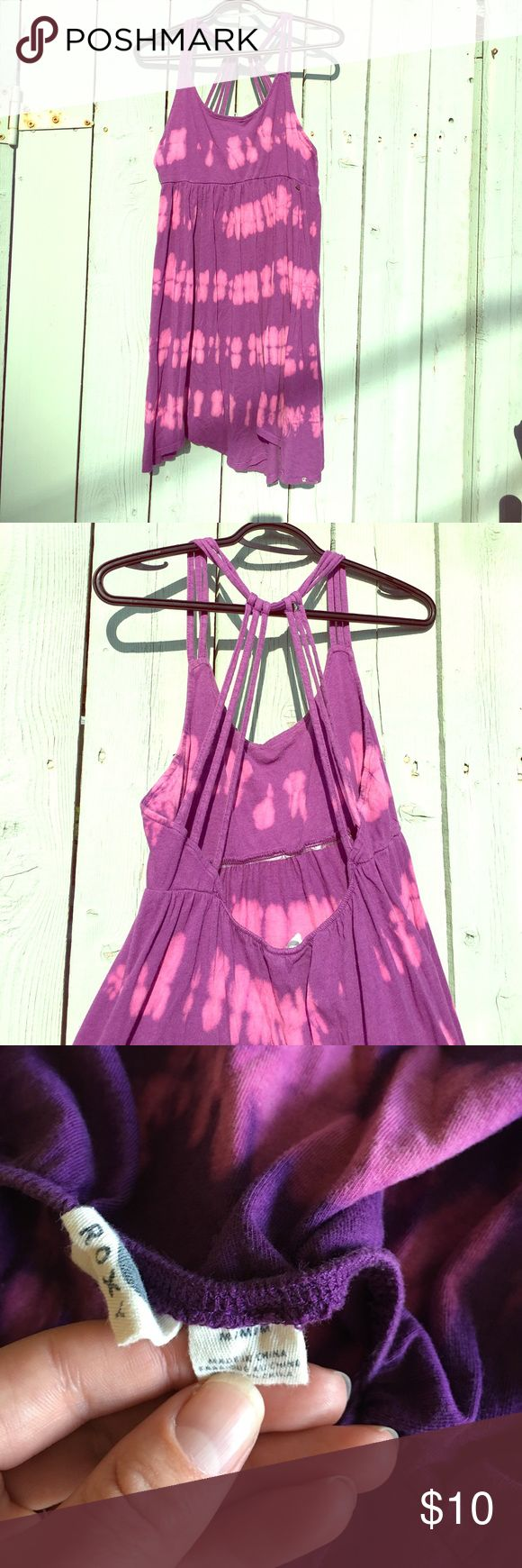 Roxy sundress. Pink & Purple tie dye Roxy sundress or cover up. Pink & Purple tie dye. Cute strappy top.  One strap broke at a festival and I duct taped it back(see photo): easy stitch fix if you can thread a needle unlike me. Dress is in great condition otherwise. Roxy Dresses Mini