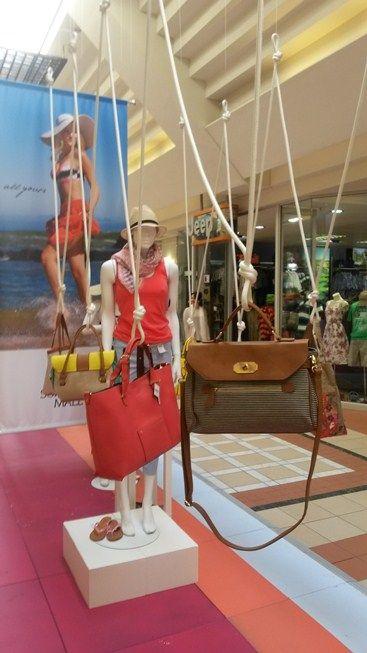 A creative and innovative display of summer handbags.