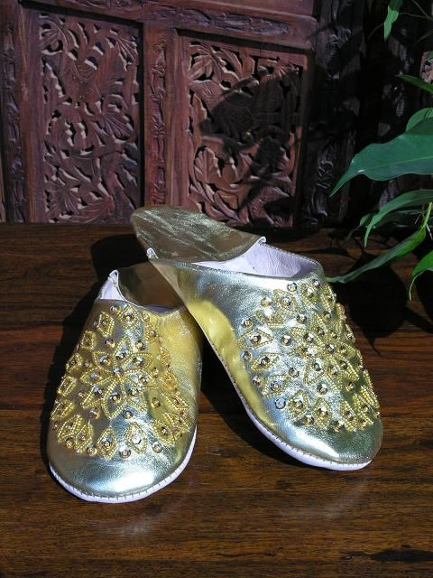 Small gold leather sequinned Moroccan slippers. http://www.maroque.co.uk/showitem.aspx?id=ENT01826&s=90-50-057