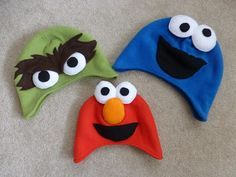 Sesame Street Hats for Halloween   a constant project  Oscar, Elmo and Cookie Monster Fleece Hats.   http://aconstantproject.blogspot.com/2013/10/sesame-street-hats-for-halloween.html