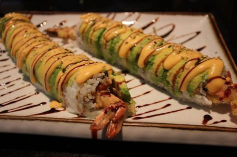 Homemade Caterpillar Sushi Roll. So easy! Restaurant quality sushi! Recipes for dynamite sauce, unagi sauce,baked volcano roll, spicy tuna roll and more all in one post!