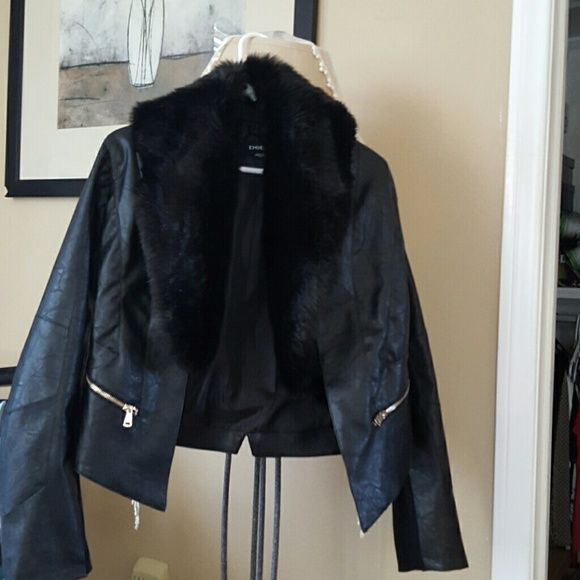 """Black Be Be jacket it's a really cool jacket never Sexy faux leather with faux fur coller. Never worn the sleeves to long for me. Looks great with tall riding boots or heeled boots. It's light weight...large but can be worn by busty med I'm 5'2"""" so sleeves long and I didn't feel like having it tailored. bebe Jackets & Coats"""