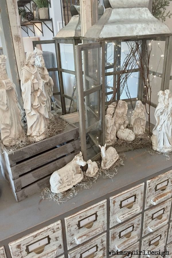 Using an oversized lantern and rustic wood crate (upside down) from HomeGoods created a unique way to display my nativity set.  It is one of my favorite Christmas vignettes in our home this year! {Sponsored Pin}