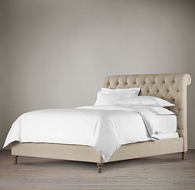RH's Chesterfield Fabric Sleigh Bed:The style, construction and comfort of a fine Chesterfield sofa, brought to the bedroom and sloped to a most inviting angle of repose. Generously padded, our bed features deep hand tufting  – a style perfected during the Victorian and Edwardian eras – accented with upholstery tacks.