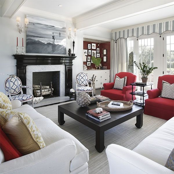 Really interesting window treatment & striking fireplace make the room. Add the red accents  and wow!