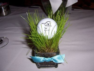 On the green golf themed wedding favors.  See more golf wedding favor ideas at one-stop-party-ideas.com