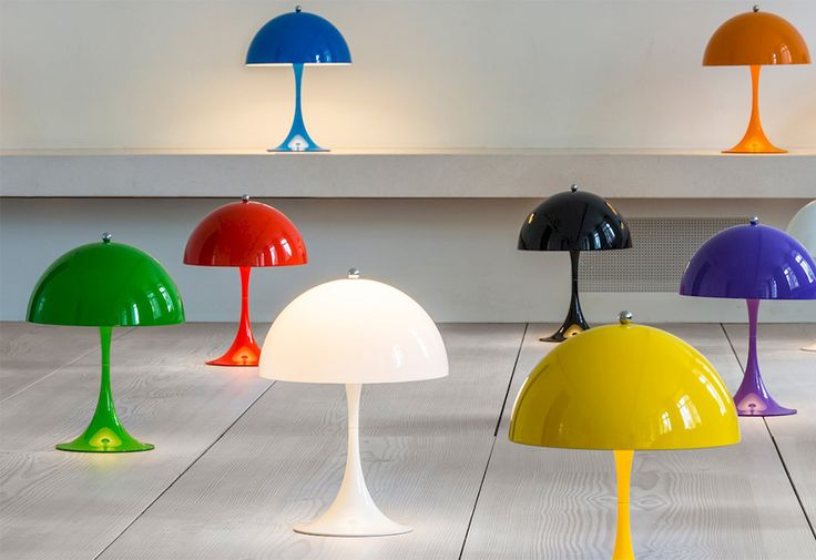 Panthella Mini table lamp by Verner Panton for Louis Poulsen.  The Panthella light perfectly expresses Verner Panton's pop design ethos. This iconic design is now available in a range of bright colours that reflect Panton's vivid and playful use of colour.  The Panthella light is designed to emit a soft and comfortable diffused light. The shade form directs light directly downwards to softly illuminate its surroundings, assisted by the white-painted inner of the shade and the reflecti...