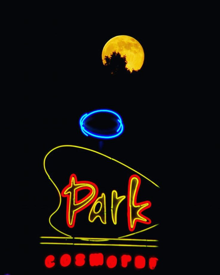 Local artist Dan Hall designed the Park Cosmorama sign in 2001. It was manufactured and installed by Frank Balton Sign Company (the same firm that built the famous Memphis Music sign on Beale near B.B. Kings). The sign is 35 feet of aluminum steel and neon and the planet-like sphere at the top rotates at 1 RPM.   It looks its best at night don't you think?