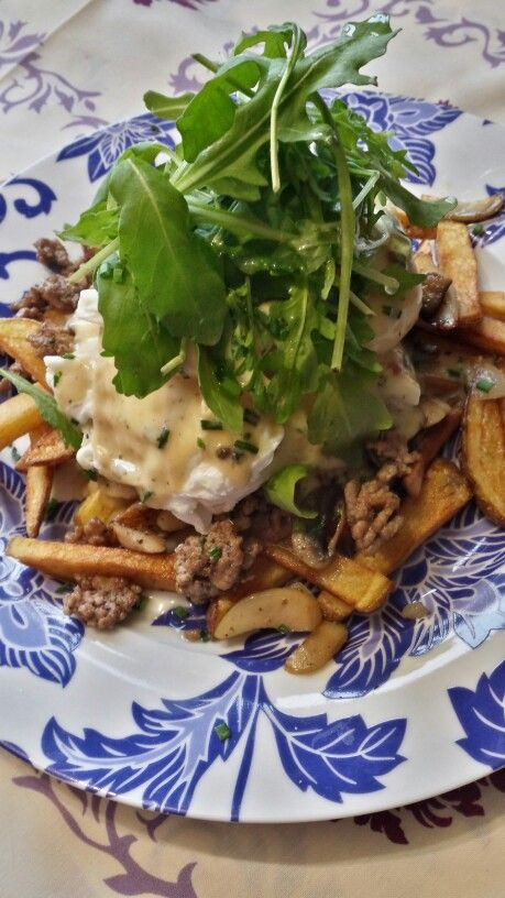 Eggs benny poutine with wild mushrooms, beef and aged cheddar beer brie sauce