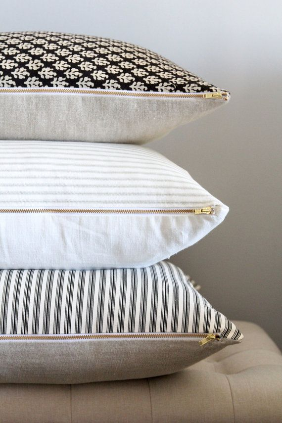 Designer curated custom pillow with vertical black ticking stripes, neutral dark oatmeal back and an exposed brass zipper. Fabric Details: Cotton & Linen Blend Colors: black ticking stripe & dark oatmeal Features: brass zipper & knife edge construction Size: 18 x 18 square Care: Machine wash cold / gentle cycle or hand wash with a mild detergent / air dry. Professional cleaning is also recommended. Pillow insert is not included. *If you do want an insert please contact me directly as…