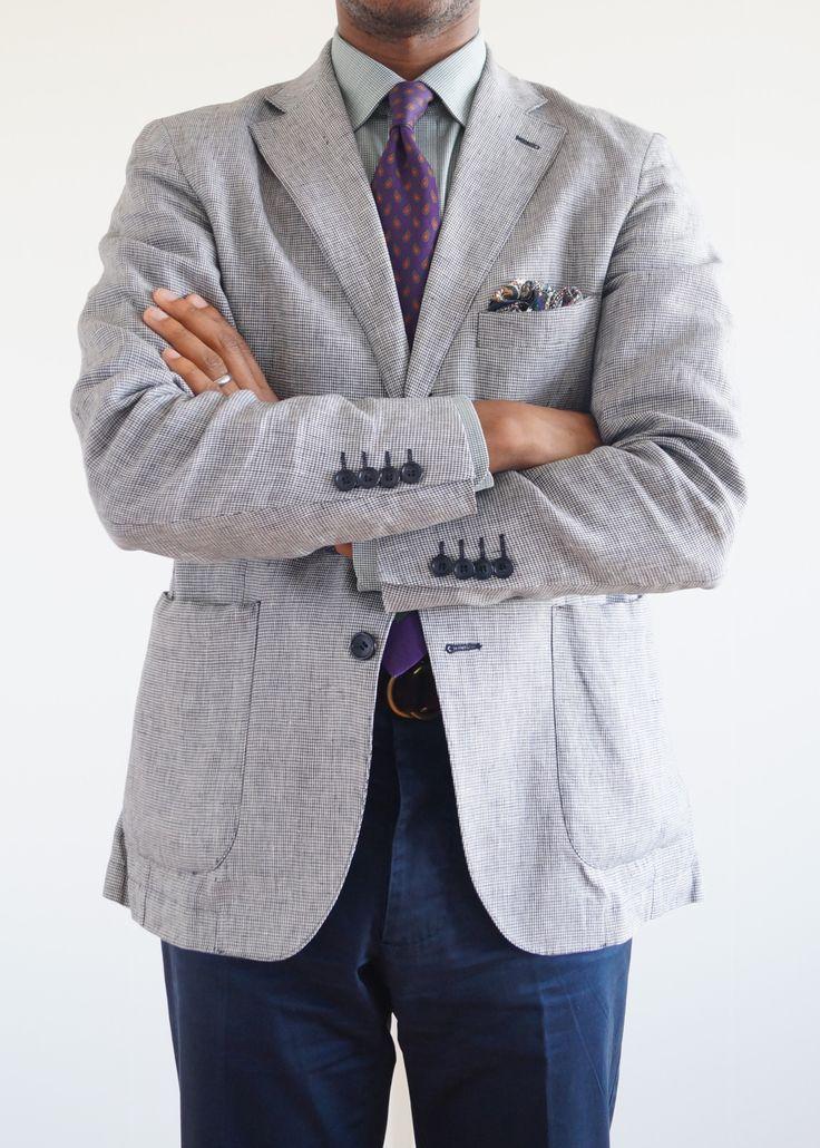 Light grey sport coat, green shirt, purple tie, navy pants