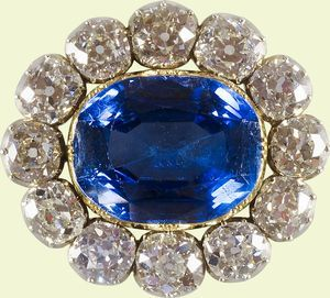 "Prince Albert's Sapphire Brooch, also known as Queen Victoria's Wedding Brooch. Prince Albert presented this large oblong sapphire set in gold and surrounded by 12 round diamonds to Queen Victoria on February 9, 1840 - the day before their wedding. She duly wore her present from ""dearest Albert"" on their wedding day and frequently afterwards, up until Albert's death."
