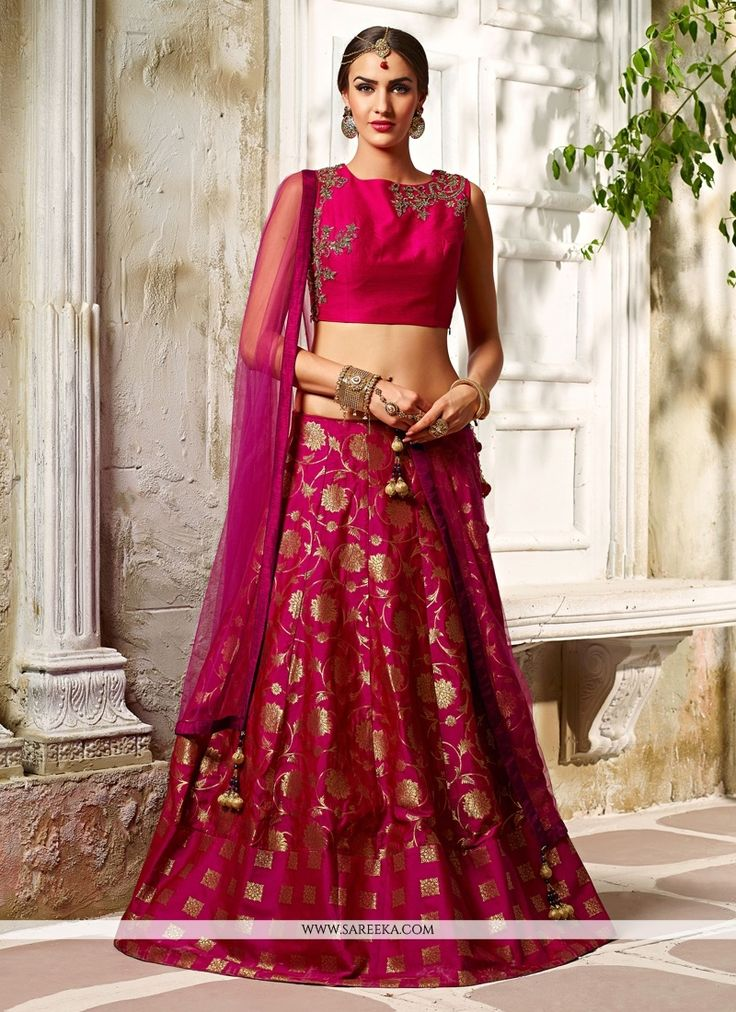 This season your look gets better definition with just a little attention to detail. Keep ahead in trend with this magenta banarasi silk, brocade and net a line lehenga choli. The desirable embroidere...