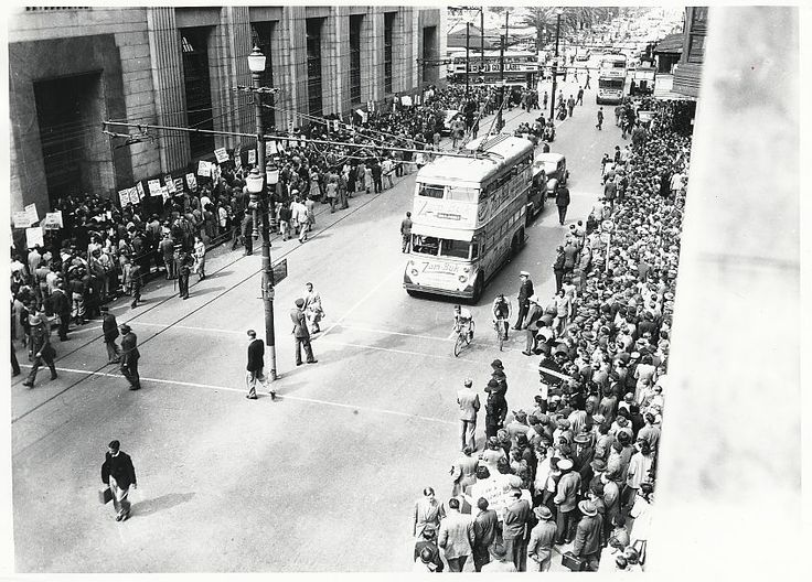 During a lunchtime anti-apartheid demonstration in Darling Street, Cape Town, people lined the street in front of the General Post Office to protest petty apartheid policies in post offices in the Cape Peninsula. The Cape Times newspaper described the approximately 1000 demonstrators as communists. September 14, 1949