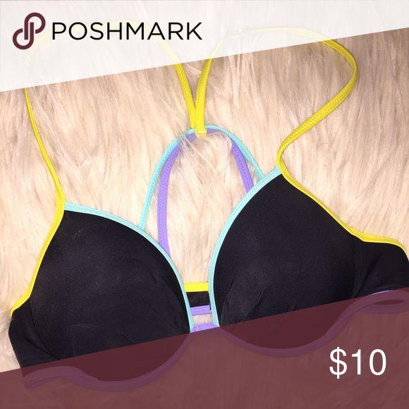 VS bikini top Black, blue, purple and lime VS bikini top. Worn once and in great condition. Open to bundles and trades. Crosses in the back Victoria's Secret Swim Bikinis