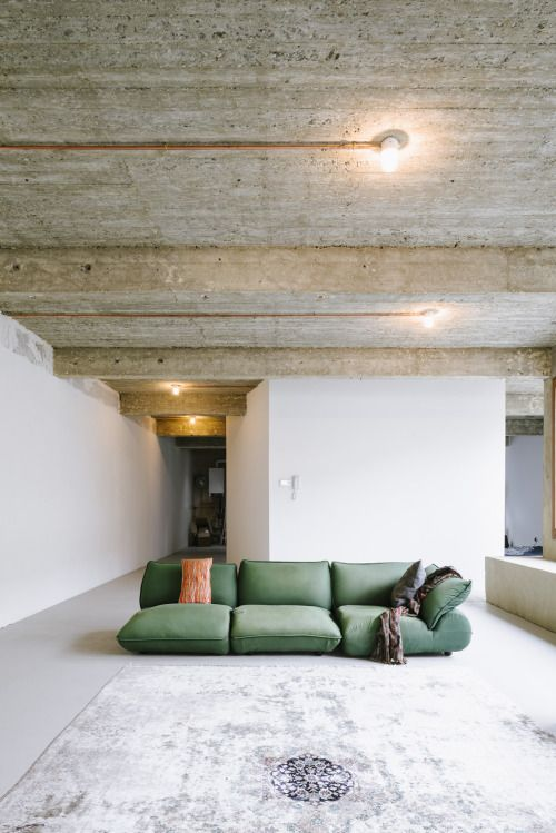 Reconversion of warehouse, Anderlecht - by Carton123 architecten, photo by Olmo Peeters; board marked concrete soffit, copper conduit for surface mounted lighting