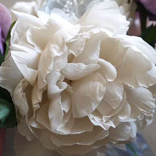 The Purdy in Bloom Peony is a striking and lush concoction of layers and layers of curling and dancing petals. Stunning hand crafted Silk Flowers for weddings and special occasions. http://www.purdyinbloom.com/