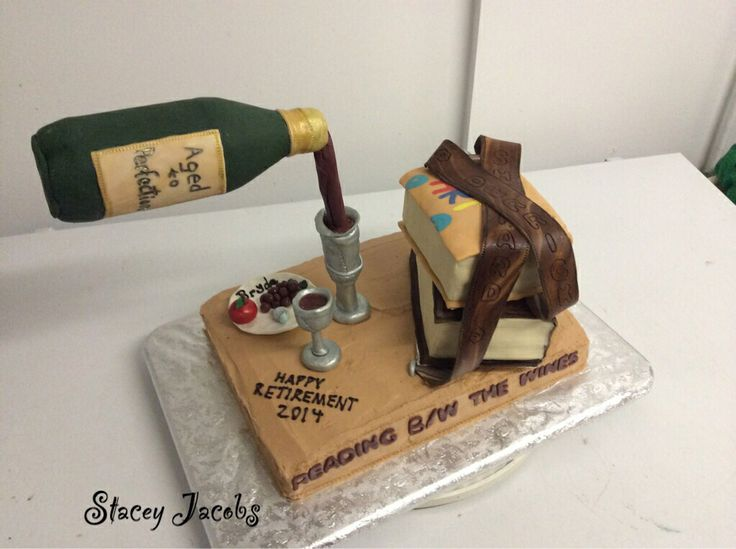 Retirement cake for two teachers.  She's an avid wine lover and he's into leather crafting.