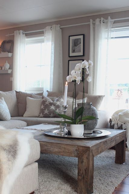 A gorgeous dusty brown and cream combination living room creates the perfect relaxing and warming space. We just adore this room!