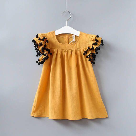 pom-pom fun mustard dress // toddler dress