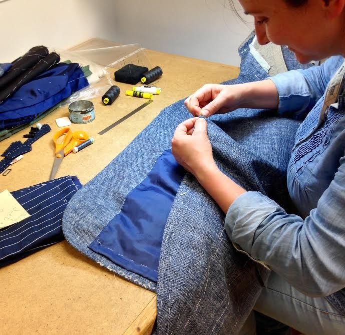 Our lovely hand finisher Olga is carefully prick stitching, an open weave summer blazer is in the making.