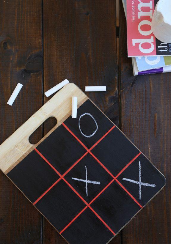 Chalkboard tic tac toe with cutting board.