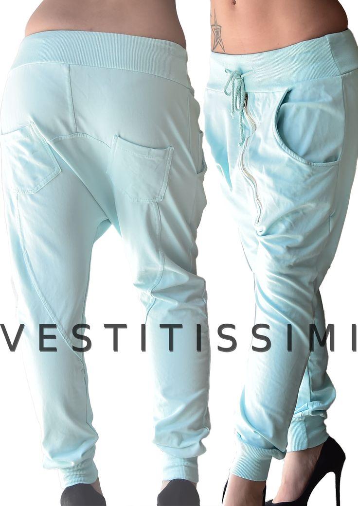 Pantalone donna sportivo colore celeste con zip obliqua, tasche e laccio in vita.