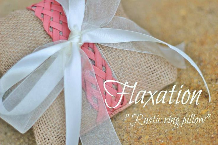 Rustic ring pillow in hessian with a flax band and ribbons.                      www.flaxation.co.nz