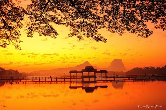 """Hpa An =  Hpa An is the photogenic capital of Kayin State on the Thanlwin River. About a 7-hour drive southeast from Yangon, the town is surrounded by Karst mountains and is great place for short, scenic treks. Outside of town there are seas of green rice paddies backed by Karst rock formations. Mt. Zwegabin is the most prominent """"rock"""", and can be climbed in a couple of fairly strenuous hours, but the views are a spectacular reward."""