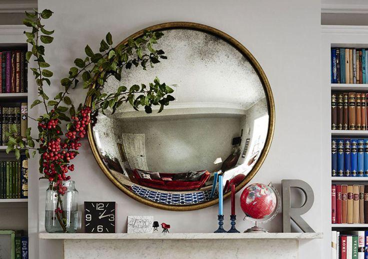 Round brass mirror above mantlepiece