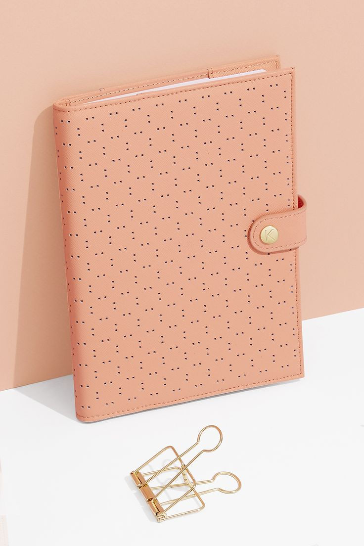 Keep notes in style with this Peach Perforated Leather Notebook Holder