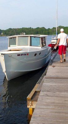 Downeast cruiser   A four year project. Built stitch and glue using Meranti Marine Plywood. Powered by a Honda 90 Four Stroke.