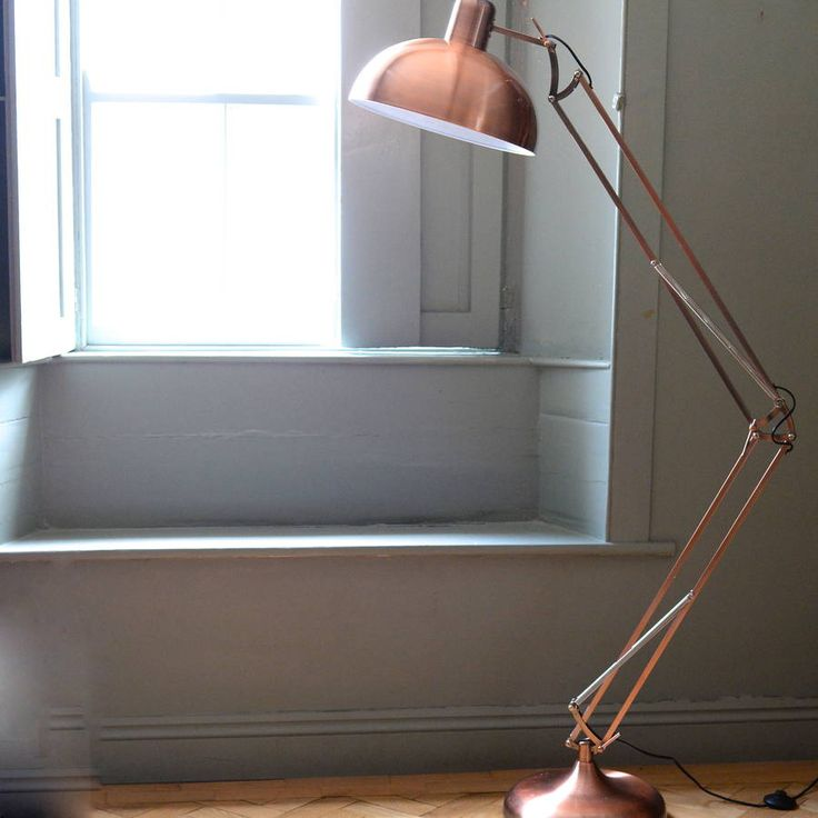 A fantastic floor standing angled lamp.Red, copper plated, brushed copper, gold colour.This adjustable floor lamp comes in a really vibrant copper coloured metal and is great to have over your desk or beside a chair or sofa as a reading light. It has a good, sturdy base and so can also just be used as a free standing lamp to add a funky, contemporary feel to a room.Metal.190 x 36 x 36cm