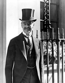 Neville Chamberlain 18 March 1869 – 9 Nov 1940) was a British Conservative politician who served as Prime Minister of the UK from May 1937 to May 1940. He is best known for his appeasement foreign policy, & particularly for his signing of the Munich Agreement in 1938, conceding the Sudetenland region of Czechoslovakia to Germany. After Hitler continued his aggression by invading Poland, Britain declared war on Germany on 3 Sept 1939