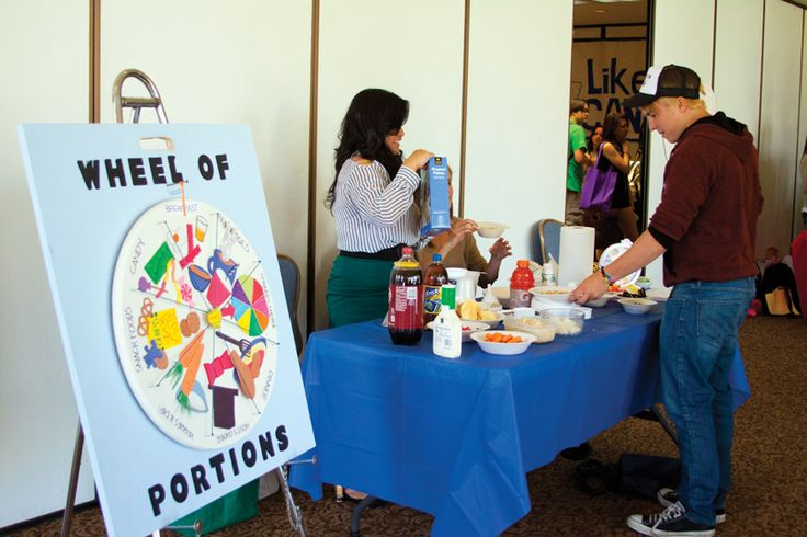 Students interact with the booth dedicated nutrition at the annual Wellness  fair sponsored by the Health Promotion and Wellness Service Department. Photo by Khlarissa Agee /   The Collegian