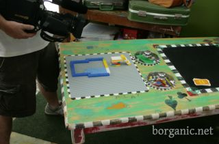 Outdoor Lego table - she sunk metal pots w/lids into the table to hold the Lego pieces and keep the dry/bug free.