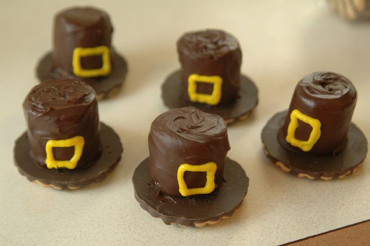 Chocolate covered marshmallow, chocolate cookie and a little yellow candy piping make cute pilgram hats!
