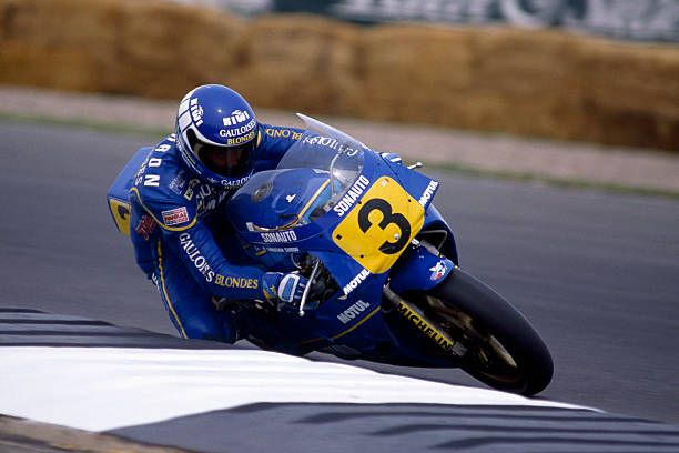 Christian Sarron of France riding a Yamaha YZR during the British Motorcycle Grand Prix at Silverstone on 3rd August 1986