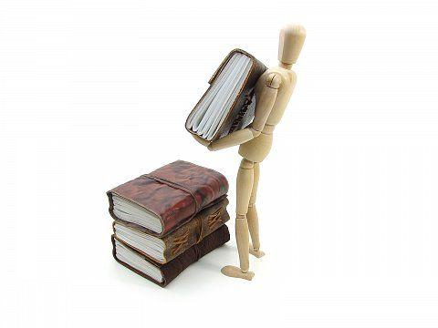 Konzeptbild - Bücher stapeln
