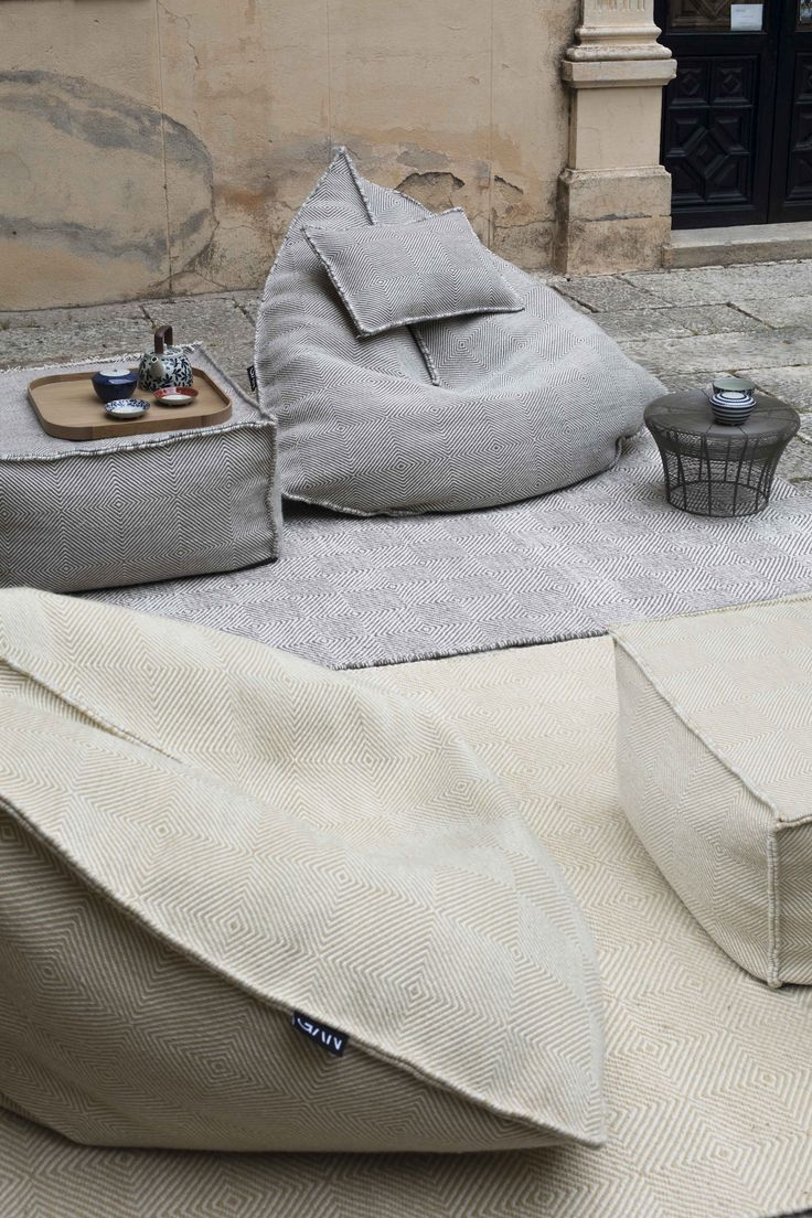 These modern loungers provide cradling back support along with sides that poof up to comfortably hold your arms, allowing you to lounge in comfort for a nice long while.