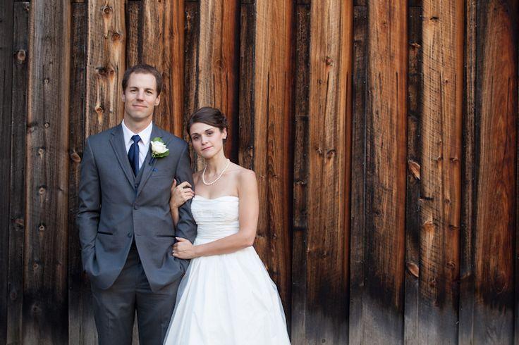 Bride and groom at wooden barn in Vineland Estates