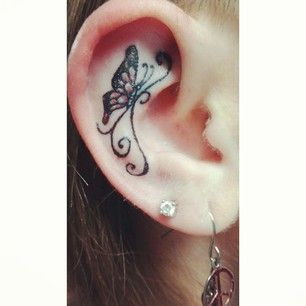 A cute little butterfly. | 31 Ideas For A Delicate Inner-Ear Tattoo
