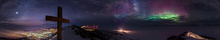 A year in photos: The extreme light changes of Antarctica. June is the darkest month. Saturn is the bright dot in the sky on the left, McMurdo base is the bright sprawl of lights, and New Zealand's Scott Base is the small, bright light in the center. The central red dots are the wind turbines that are almost always turning, and the tiny light on the right is the sole beacon from the ice runway, awaiting flights when the sun rises again. INSANE picture!!! wow