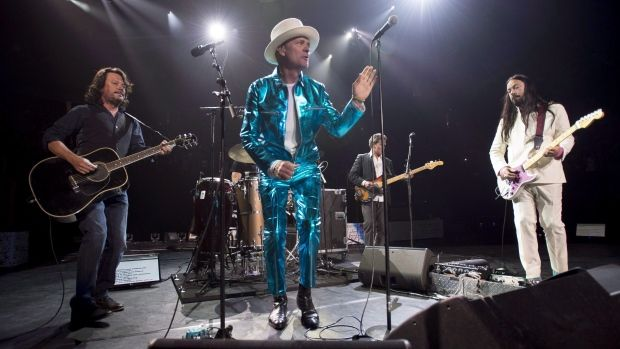 The Tragically Hip, shown performing in Vancouver, raised more than $1 million…
