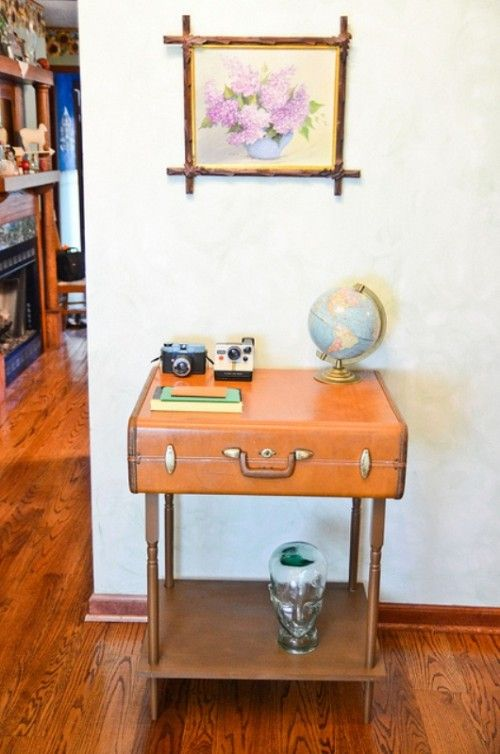 Fashionable DIY Suitcase Side Table | Shelterness - I've seen a suitcase used before, but this one has an extra shelf.  Great idea.