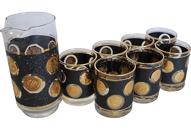 Mid-Century Modern coin-motif martini pitcher with matching set of seven glasses.Received these as a wedding gift 2956