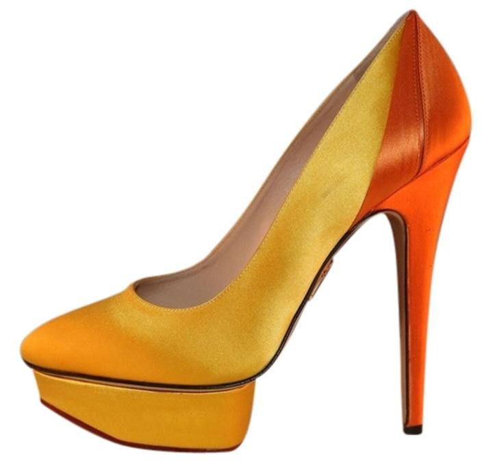 "Elevate your stature—and your spirits—in this bright and bold Charlotte Olympia pump. - Two-tone crepe de chine makes a sleek, decisive statement. - Round toe rests on 1 1/5"" island platform. - 5 3/4"""