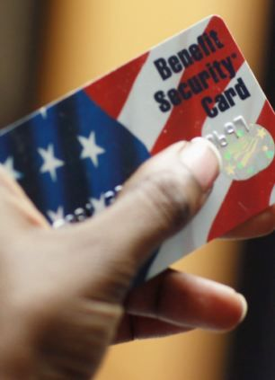 A Federal food stamps card is used to purchase food in Fort Lauderdale, Florida. Shocking US government leaflet tells Mexican immigrants they can collect food stamp benefits without admitting they're in the country illegally.