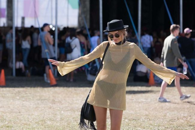 """Splendour 2016: The best street style from the festival: Who: Kate Fenton Occupation: Barista and model. Wearing: Princess Polly everything, Sportsgirl hat. Outfit inspo: """"Kind of sassy. It feels majestic, but breezy."""""""